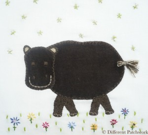 Borduurwerk nijlpaard gewaarmerkt