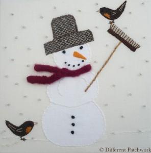 Borduurwerk sneeuwman gewaarmerkt