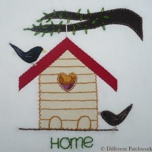 Borduurwerk vogelhuis gewaarmerkt