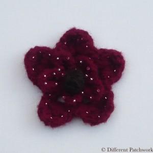 Vilt middel bloem bordeaux rood gewaarmerkt